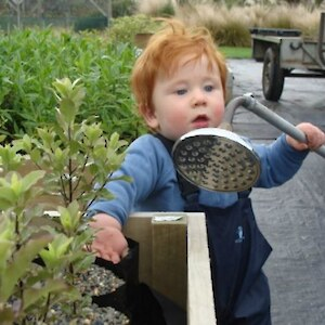 Starting young - Dylan helping with watering